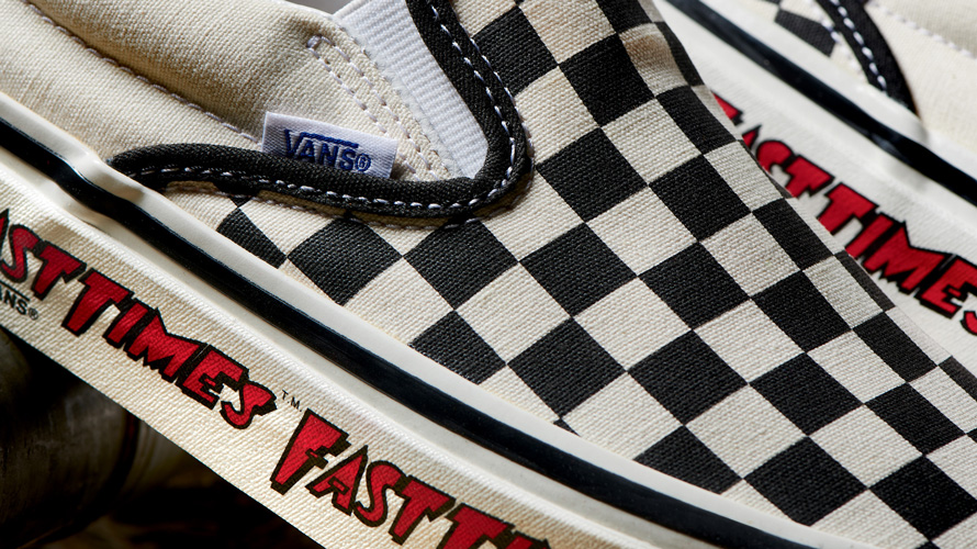 close up of front of checkerboard vans
