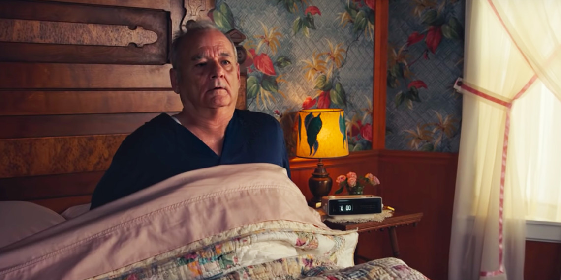 bill murray laying in bed looking like he suddenly woke up
