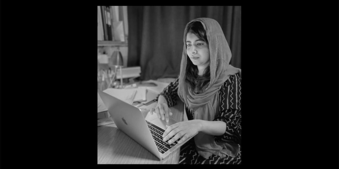 Humanitarian Malala Yousafzai works at a MacBook