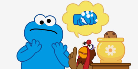 Cookie monster being told about handwashing