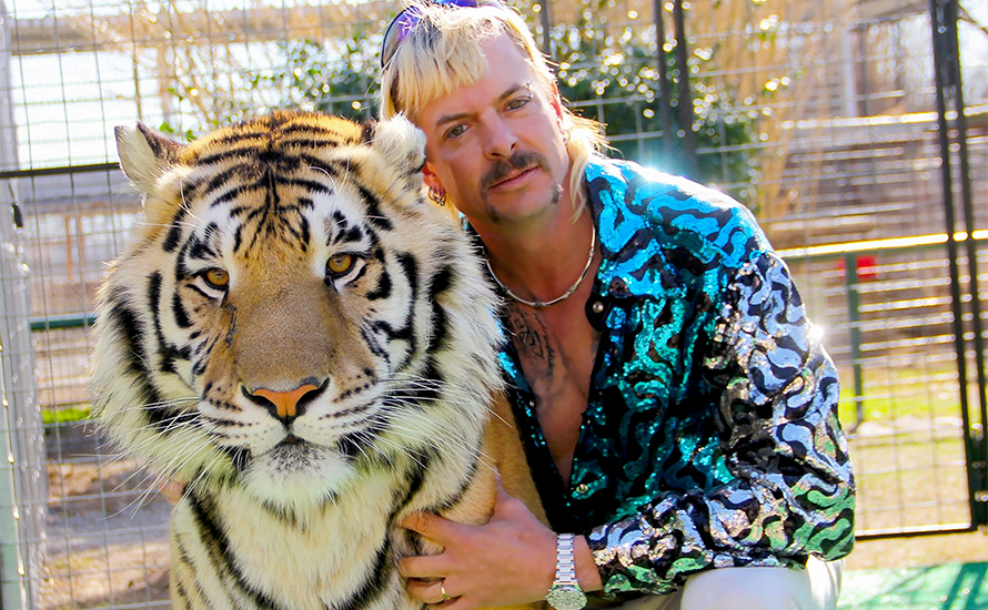 Photo of Joe Exotic and a tiger