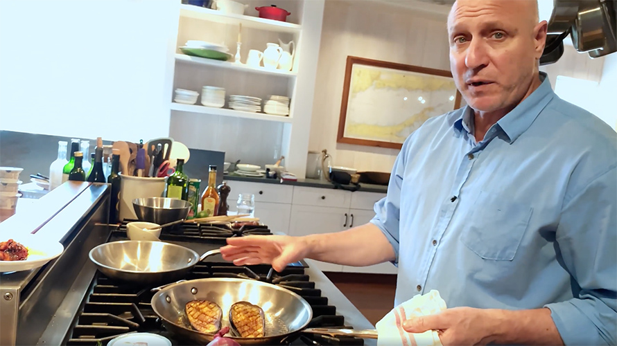 Celebrity chef Tom Colicchio cooking in kitchen