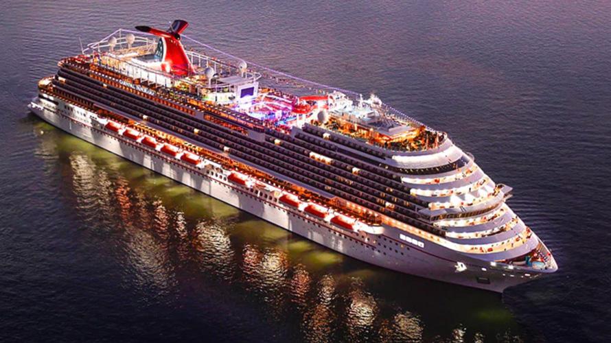 a lit cruise ship at night