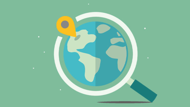 Pin on map under magnifying glass