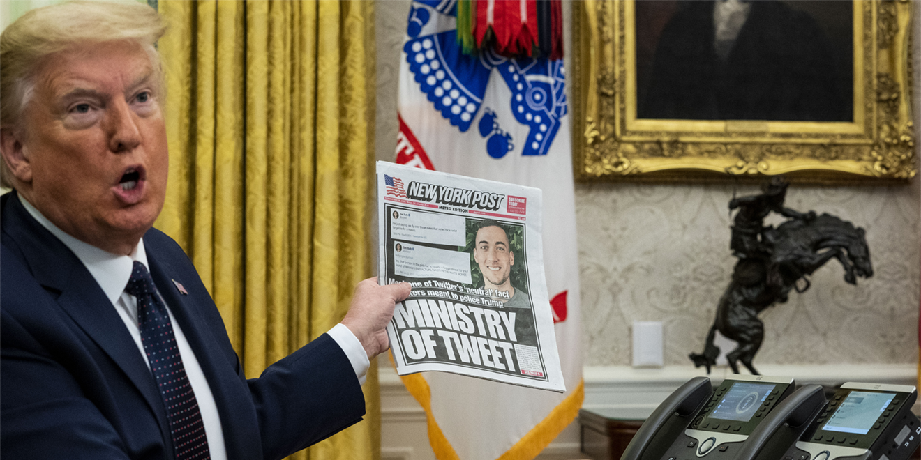 trump holding up a copy opf the daily news
