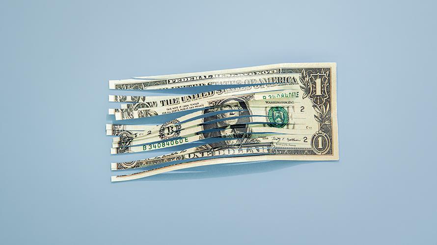 a cut up dollar bill
