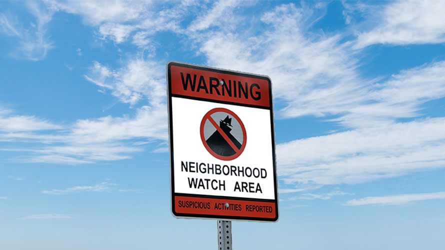 a red and white sign that says warning neighborhood watch area