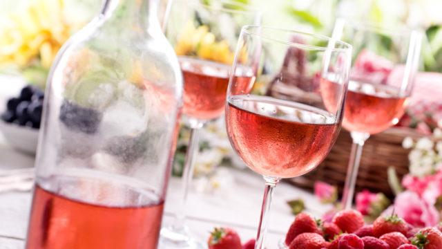 rose bottle and full wineglasses