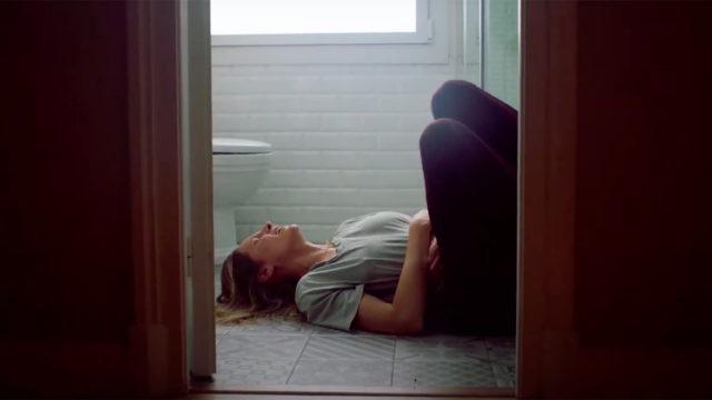 Woman in pain on the bathroom floor
