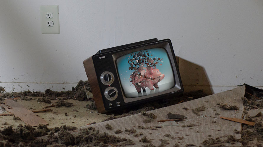 A TV on the floor with a smashed piggy bank on the screen
