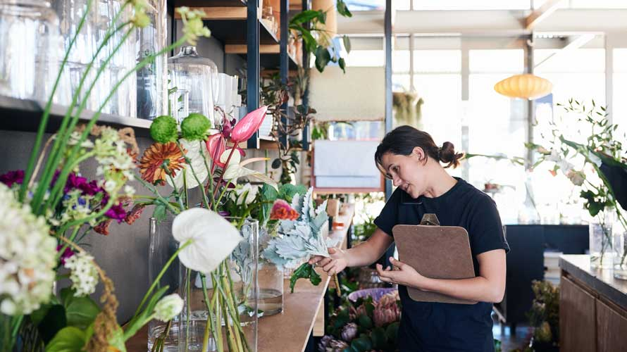 woman with clipboard in flower shop