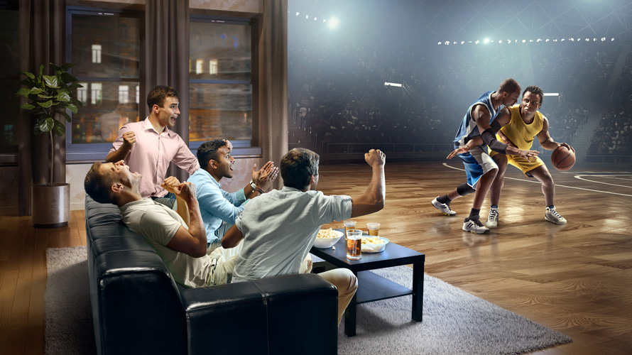 people watching sports on their sofa