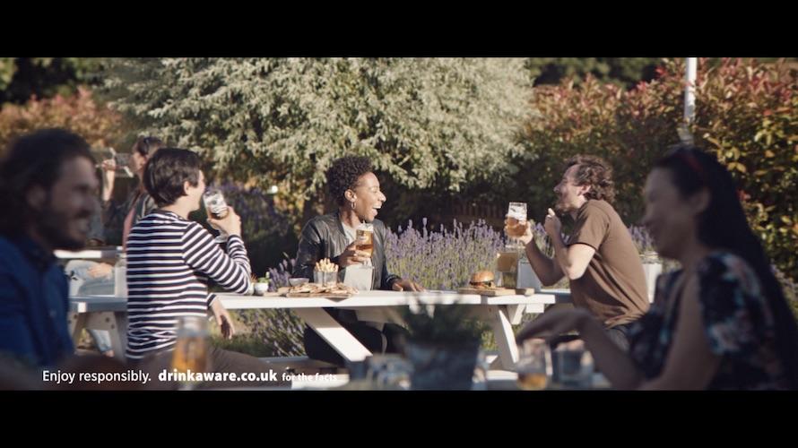 Friends sat in pub garden
