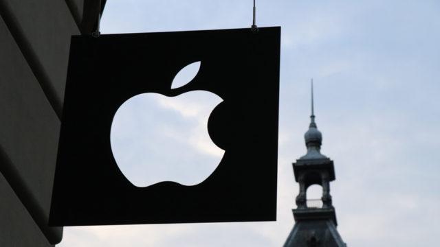 black apple logo hanging outside a storefront