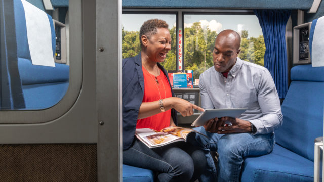 two people in an amtrack compartment