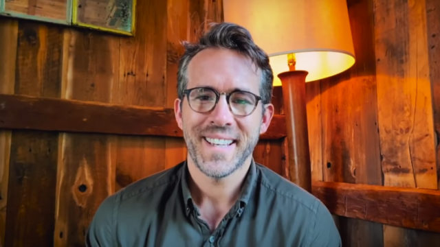 headshot of ryan reynolds in a library