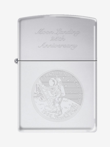 closeup of a silver zippo with a man walking on the moon engraved