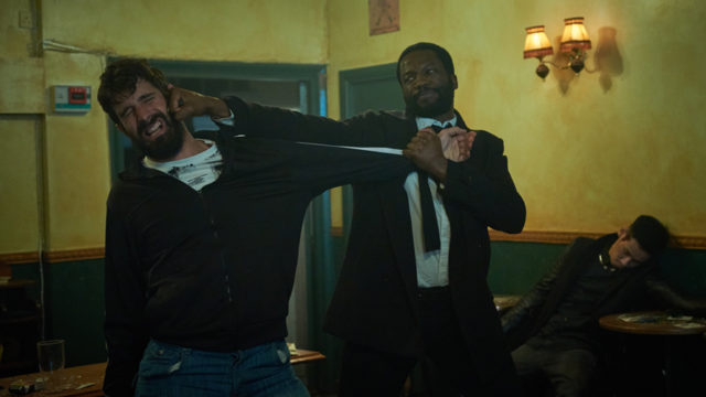 a man pinching another grimacing man