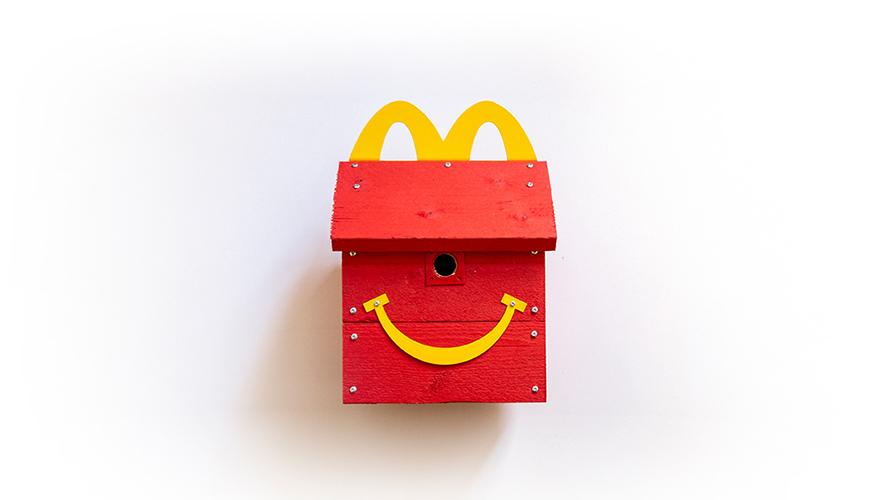 a bird house shaped like a mcdonald's happy meal box