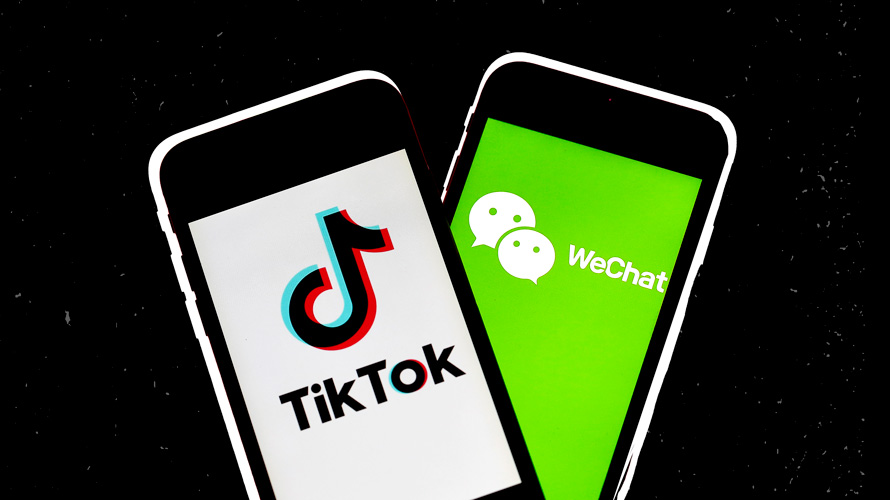 two phones, one with the tiktok logo and one with the wechat logo
