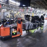 An AutoGuide automated guided vehicle carries parts and other items inside the Toyota Motor Manufacturing plant in Georgetown.
