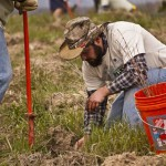 UK Landscape Architecture senior, Cameron Stone, plants a seedling on the land where Flight 93 crashed on 9/11. The site is now a national memorial. Volunteers will plant 13,000 trees on 150 acres over six years.