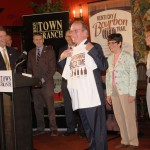 Dr. Pearse Lyons shows off his new Kentucky Bourbon Trail T-shirt.