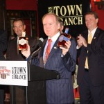 """Dr. Pearse Lyons, president of Alltech, displays two Town Branch Bourbons, the original and one called """"Title Town."""""""