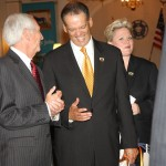 Gov. Steve Beshear and Bingham Chaiman Jay Zimmerman share a laugh before the start of the welcome ceremony. At right is Bingham CEO Tracee Whitley.