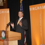 Jay Zimmerman, chairman of Bingham McCutchen, speaks Thursday at the company's welcome ceremony at City Hall. At left is CEO Tracee Whitley, and in the right corner are Lexington Mayor Jim Gray and Gov. Steve Beshear.