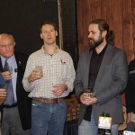 """Paul Tomaszewski, founder and Master Distiller at MB Roland, explains the """"new make,"""" a special drink made from water and grains from each of the seven distilleries' secret recipes. The drink was used to toast the announcement of the launch of the Kentucky Bourbon Trail Craft Tour."""