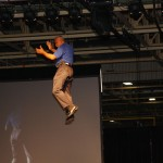 Will James, president of Toyota Motor Manufacturing Kentucky, is lowered from the ceiling as he begins the 2013 Avalon celebration.