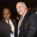 Larry Hayes, right, secretary of the Cabinet for Economic Development, greets Wil James, president of Toyota Motor Manufacturing of Georgetown.