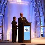 Linda Antus, president and CEO of Cincinnati USA Regional Tourism Network, and Eric Summe, CEO of the Northern Kentucky Convention & Visitors Bureau, make a presentation at the CVB's Annual Meeting.