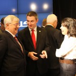 Rep. Ryan Quarles, R-Georgetown, center, speaks with other attendees of the Lexus new conference.