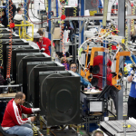 Production employees work on the new GE frontload line. Two new assembly lines, costing over $100 million, have begun producing high-efficiency frontload washers and dryers, adding 200 jobs to Appliance Park in Louisville, Ky. (Photo courtesy of GE)