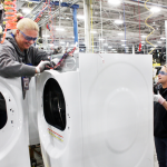 Shelly Schneidtmiller and Stefani Schultz, production employees, work on the new GE frontload line. Two new assembly lines, costing over $100 million, have begun producing high-efficiency frontload washers and dryers, adding 200 jobs to Appliance Park in Louisville, Ky. (Photo courtesy of GE)