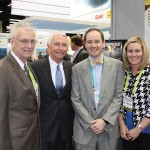 Kentucky Gov. Steve Beshear visits with a team of Owensboro, Ky., representatives at the Greater Owensboro Chamber of Commerce Economic Development Corp.'s booth at the BIO Convention in Chicago. From left are: Al Mattingly, Daviess County judge/executive; Beshear; Madison Silvert, vice president of the Greater Owensboro Chamber of Commerce Economic Development Corp. and executive director of the Emerging Ventures Center for Innovation; and Jessica Boarman, office manager of the Greater Owensboro Chamber.