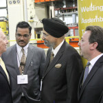 Gov. Steve Beshear speaks with Thunder Tool owners Rakesh Choudhary, B. Singh Hansra and Louie Paonessa. Sen. Jared Carpenter, R-Berea, stands in the background.