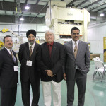 Thunder Manufacturing owners Louie Paonessa, left, and B. Singh Hansra, second from right, and Rakesh Choudhary have chosen Don Watts as the Richmond facility's plant manager. The Richmond plant is the Canadian company's first American facility.