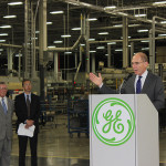 UK President Eli Capilouto, at podium, speaks Thursday at a ceremony announcing a research partnership with GE Appliances in Louisville. GE Appliances' products include refrigerators, freezers, cooking products, dishwashers, washers, dryers, air conditioners, water filtration systems and water heaters. At left are UK Vice President for Research Jim Tracy and GE Appliances Vice President of Technology Kevin Nolan.