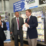 Agriculture Commissioner James Comer chooses a gallon on Udderly Kentucky milk after a press conference announcing the new Kentucky Proud program.