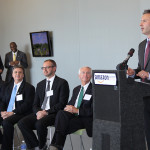 Alex Krueger, Amazon's Winchester site leader, introduces the speakers at Friday's ribbon-cutting ceremony.