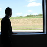 Alex Krueger, Winchester site manager, looks out the window at a walking track behind the facility. Five laps equals one mile. The track is one of many employee-focused areas.