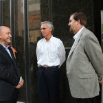 Tim Huval, chief human resources officer at Humana, left, speaks with Jim Murray, chief operating officer and Tom Noland, senior vice president of corporate communications, after a press conference about Humana's new telemedicine suite. The center will offer care to Humana's employees and covered dependents and will allow the company to evaluate expansion of telemedicine capabilities as part of its integrated care model.