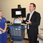 Sarah Nicholas, LPN, and Keith Borowicz, director of product management for Concentra, give a tour of the telemedicine suite of Humana's Health and Well-Being Center.