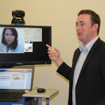 Keith Borowicz, director of product management for Concentra, gives a tour of the new telemedicine suite at the Humana Health and Well-being Center at the company's headquarters in downtown Louisville. On the screen is nurse practitioner Diane Moore.