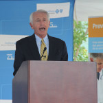 """Gov. Steve Beshear leads the crowd in """"Happy Birthday"""" to Anthem Blue Cross and Blue Shield."""
