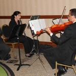 "The Leadership Louisville Luncheon Exhibit Hall was themed ""There's No Place Like Home,"" and featured an assortment of characters and a string quartet."