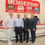 Hamburg developer Pat Madden attends the grand opening celebration for Costco, along with Costco co-founder and former CEO Jim Sinegal; Ed Lane, representating the Lexington-Fayette Urban County Government on behalf of Mayor Jim Gray; and Bob Quick, executive director of Commerce Lexington.